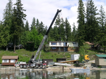 First piece of concrete to form part of the new Mabel Lake Marina floated into water.
