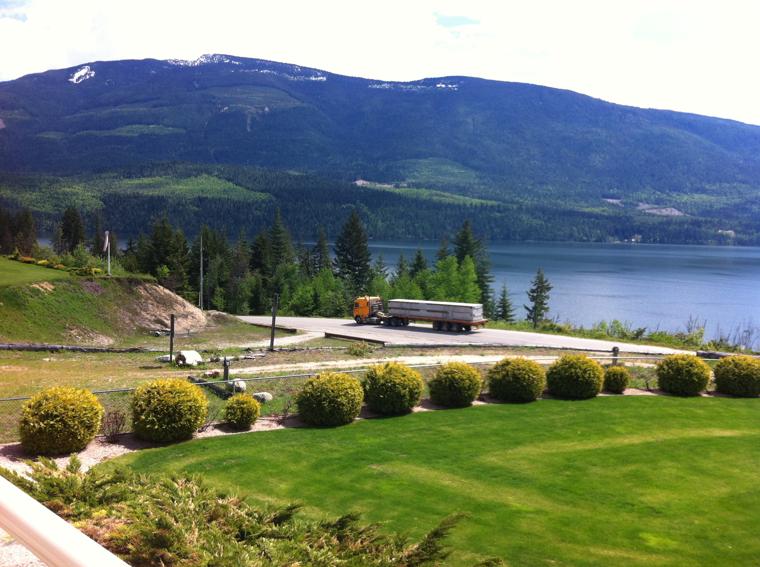 The first trucks arriving with concrete marina blocks for the new Mabel Lake Marina.